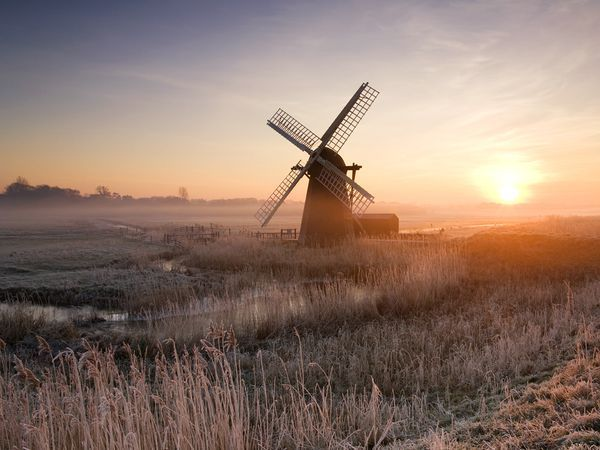 Ice covers Herringfleet Windmill, a 19th-century smock mill restored to working order. The Broads, England