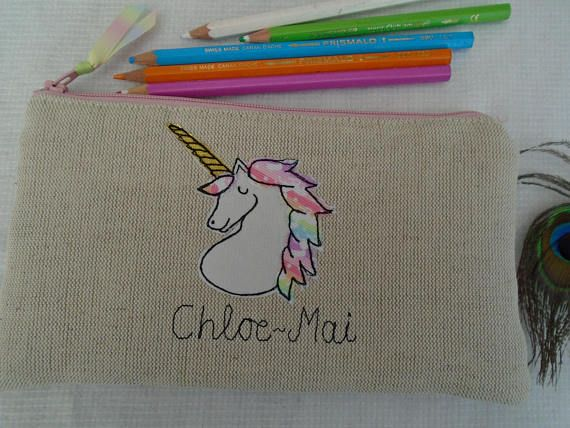 Product: Personalised Pencil Case  -Pencil case (20x10) -Unicorn design -Choice of fabrics - oatmeal linen with pink or blue accents, pink or lilac cotton or aqua linen -Choice of a name/wording up to 15 characters -Lightly padded and pink or blue unicorn lining matched to applique -Wrapped in shabby chic spotty cellophane  If you would like extra wording other than the 15 characters, please contact me, as, for an extra charge I can embroider more words on the back. How to order: After m...