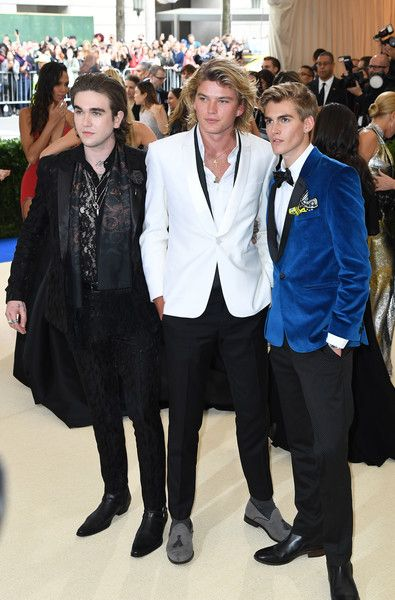 (L-R): Gabriel-Kane Day-Lewis, Jordan Kale Barrett, and Presley Walker Gerber arrive for the Costume Institue Benefit May 1, 2017 at the Metropolitan Museum of Art in New York. / AFP PHOTO / ANGELA WEISS