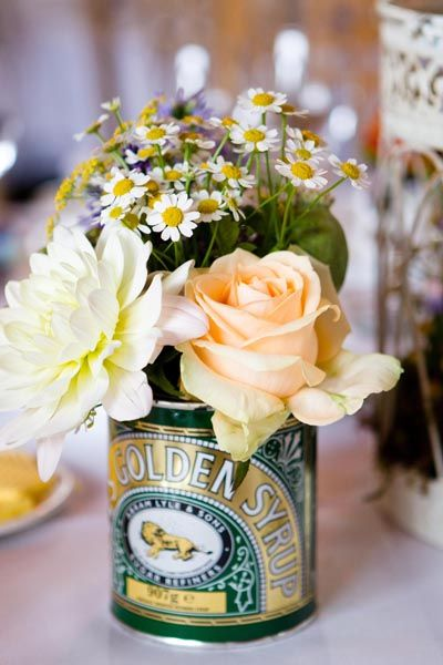 Flowers in old tin can. This is just pretty.
