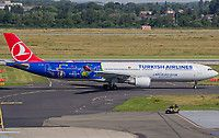 Turkish Airlines Airbus A330-303 TC-JOH aircraft, painted in ''UEFA Euro 2016'' special colours Apr.-Aug. 2016, skating at Germany Dusseldorf International Airport. 07/07/2016.