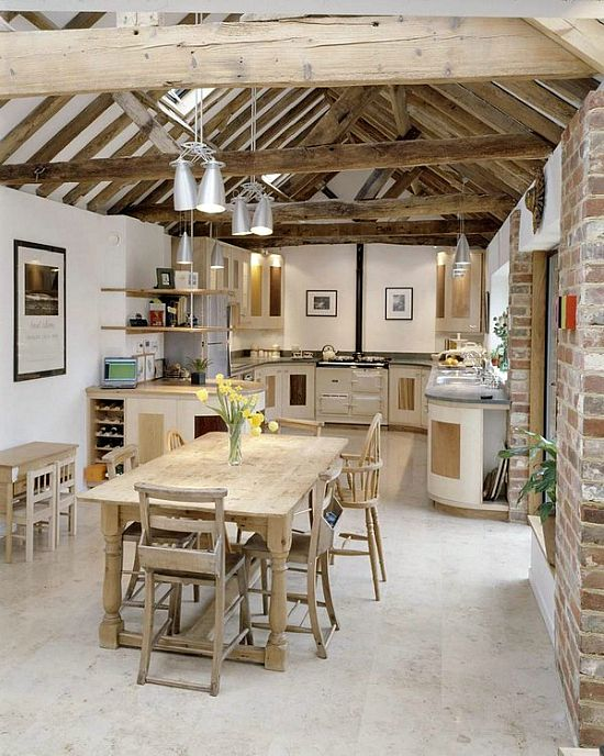 Kitchen / former barn. Love the open beam ceiling.