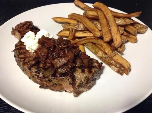 Pepper Crusted NY Strip steak with goat cheese and bacon marmalade with steak house cut fries