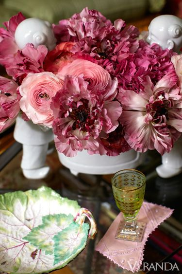 Pink ranunculus and Japanese peonies in a glazed porcelain jardiniere.