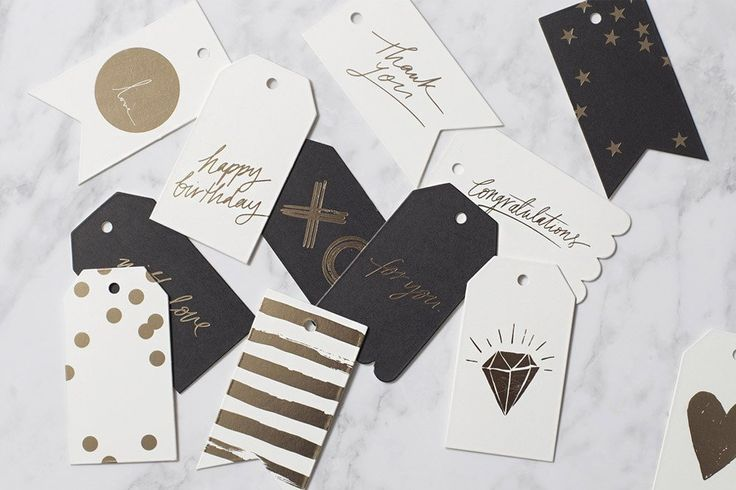 Blacklist gift tags. 50 x 90 mm. Gold foil printed onto 600gsm uncoated cardboard stock. Single sided tag with ribbon hole. Original artwork by Blacklist.