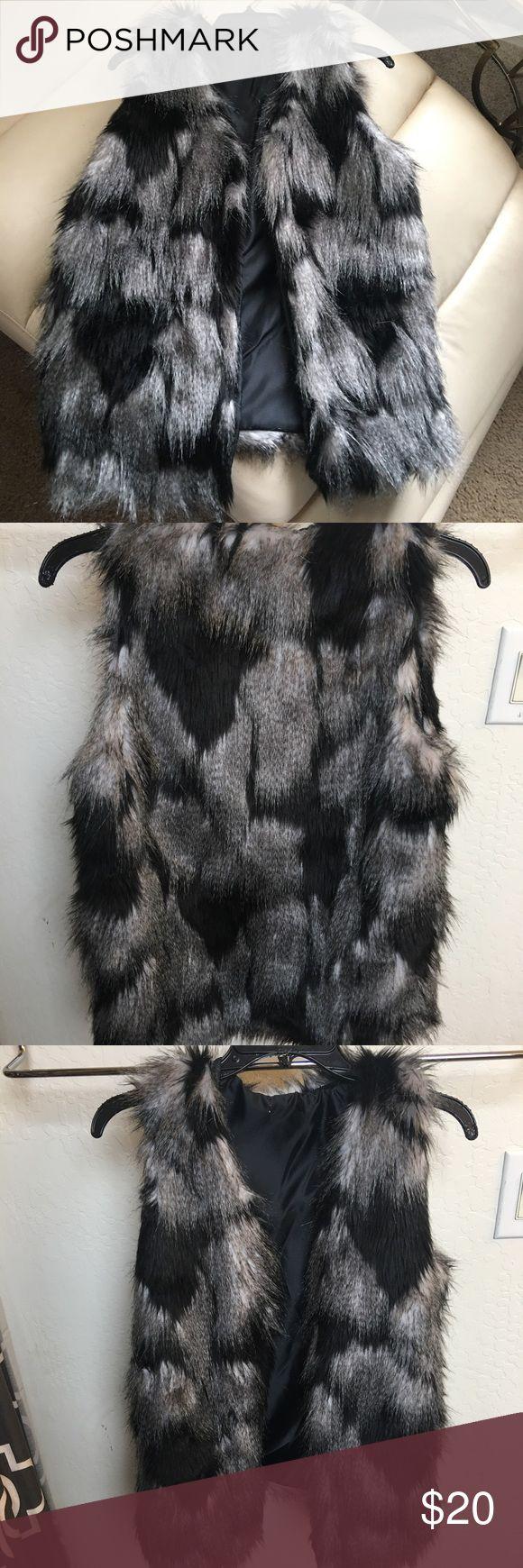 Black and White Faux Fur Vest Beautiful faux fur vest. Black and white. 52% acrylic, 48% polyester. Lining 100% polyester. Jackets & Coats Vests