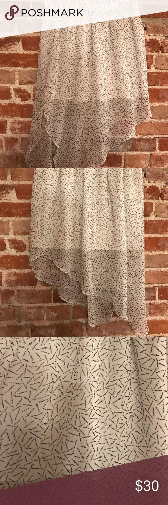 Asymmetrical BCBGeneration skirt Asymmetrical white skirt with black line design. The skirt has a shorter white liner under to add some very cool dimension to the skirt. BCBGeneration Skirts Asymmetrical