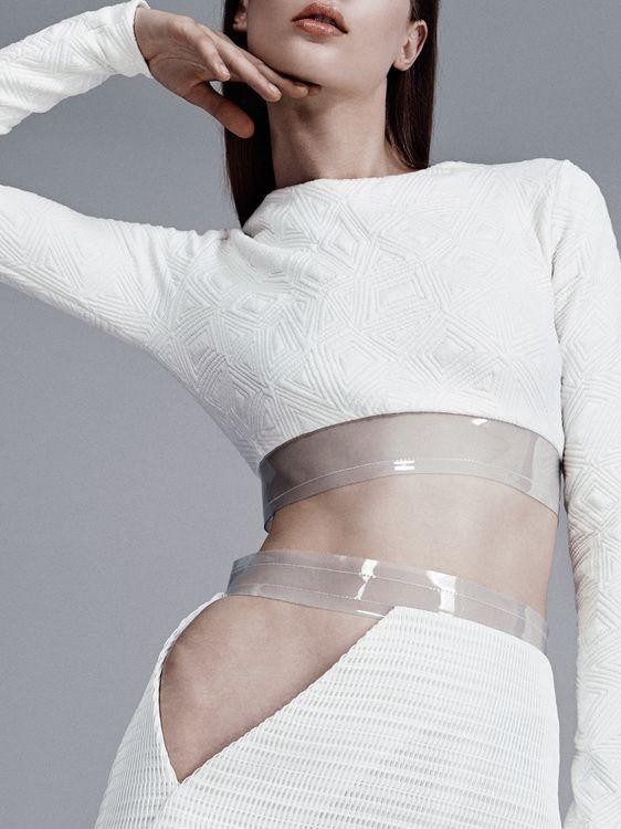 White cutout dress with transparent plastic trim; pattern cutting; fashion details // Ph. Felix Wong