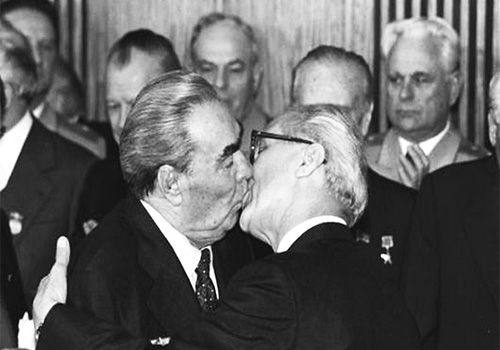 The socialist fraternal kiss became famous via Erich Honecker and Leonid Brezhnev, who were photographed exercising the ritual.