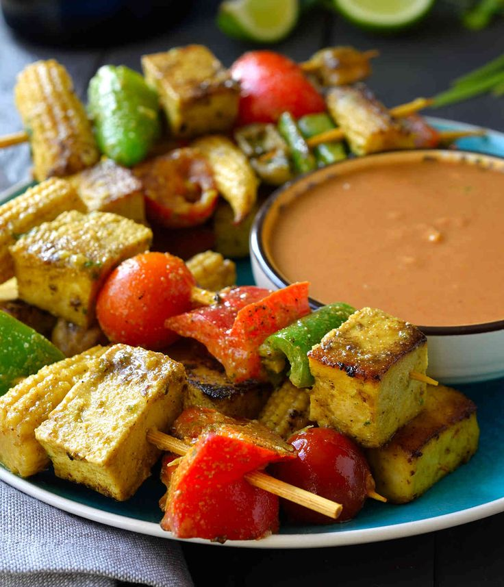 Vegan satay marinated in a coconut-curry-lime sauce then grilled and served with peanut sauce. A great vegan appetizer for your next party!