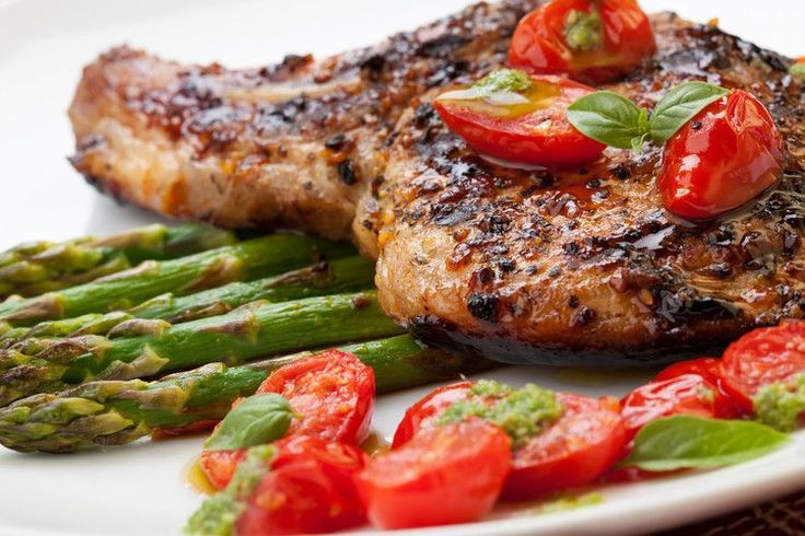 Whenyou want to whip up something wholesome and delicious, look no further than this Grilled Pork Chops with Asparagus and Pesto recipe!