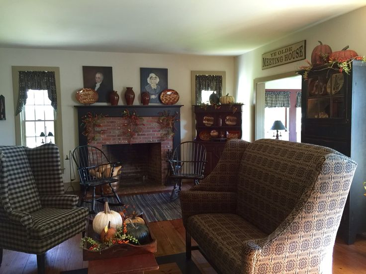 Exceptional Love The Primitive Furnishings And The Open Brick Fireplace With Black  Mantel