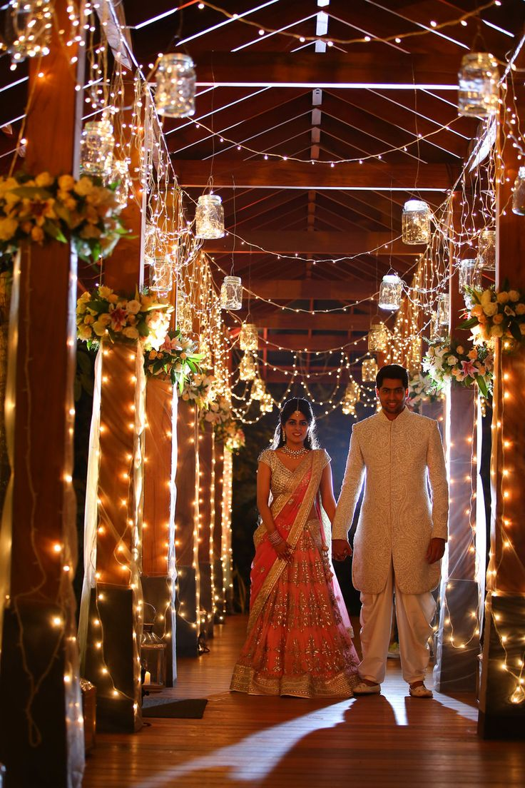 Wedding and Sangeet Decor - Cocktail Decor with Fairy Lights and Mason Jars and Hanging Flower Bouquets | WedMeGood |  #wedmegood #decorideas #DIY #indianwedding #fairylights