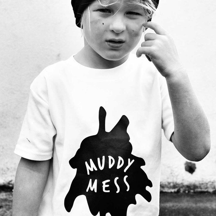 Muddy Mess T-Shirt | Now you can let kids be kids, without all the associated dirt, thanks to the Kidult and Co 'Muddy Mess' t-shirt. With this cool tee, your kids big and small can proclaim their messy credentials and wear their playtime stories with pride. Made in the UK from 100% cotton, this classic white short sleeved tee has our own design splattered on the front, with the words 'Muddy Mess' appearing in white within the black puddle of mud. Added authenticity comes from our hand…