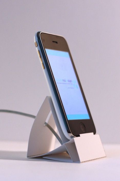 A downloadable, printable design that you can then fold to make an iPhone stand, complete with space to tuck your charger cable. Neat indeed.