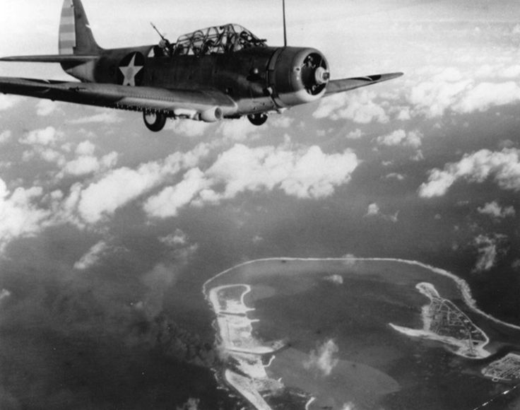 """""""A TBD Devastator flies over Wake Island after bombing it on February 24…"""