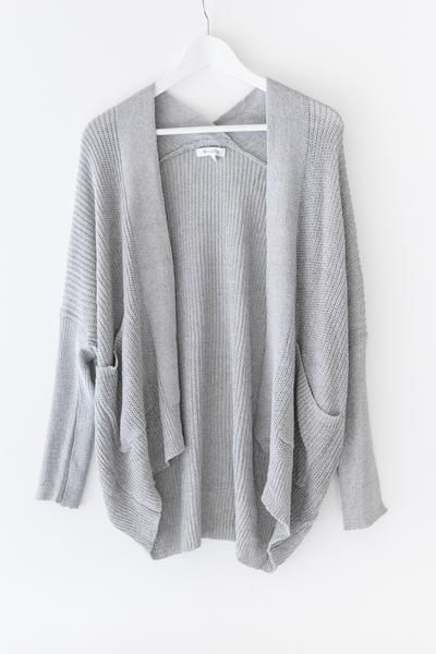 - Lightweight slouchy knit cardigan - Fitted ribbed knit long sleeves - Dropped shoulder - Available in Grey or Ivory - 55% Cotton 45% Polyester - Imported