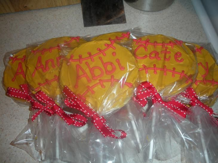 Softball+cookies+-+Party+favors+at+a+softball+birthday+party.++Each+party+goer's+name+was+written+on+their+softball+cookie+pop.++Yellow+buttercream+and+red+royal+icing.