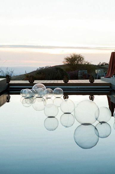 Clear beach balls to add dimension to the pool for cocktail hour. Photo: Dave Medal. Location: Pangea Vineyard Estate.