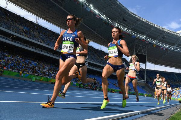 Kim Conley and Shelby Houlihan of the United States compete during the Women's 5000m Round 1 - Heat 1 on Day 11 of the Rio 2016 Olympic Games at the Olympic Stadium on August 16, 2016 in Rio de Janeiro, Brazil.