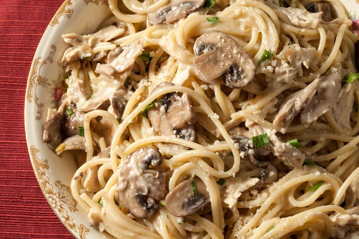 A classic creamy chicken and mushroom spaghetti recipe. You will need a yellow onion, cremini mushrooms, thyme, cooked chicken, milk, and Parmesan.