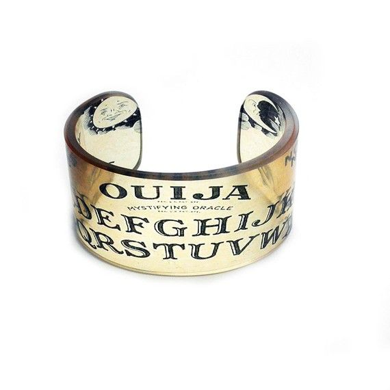 The creepy and spooky Ouija board image creates a sweet little bangle that is fun, fresh and funky.    Cuff Ouija Resin Graphic Cuff Resin Bangle Resin cuff by BuyMyCrap, $40.00