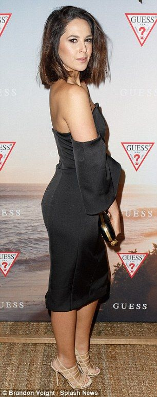 A leggy display: Radio host Zoe Marshall opted for a neautral black evening dress......