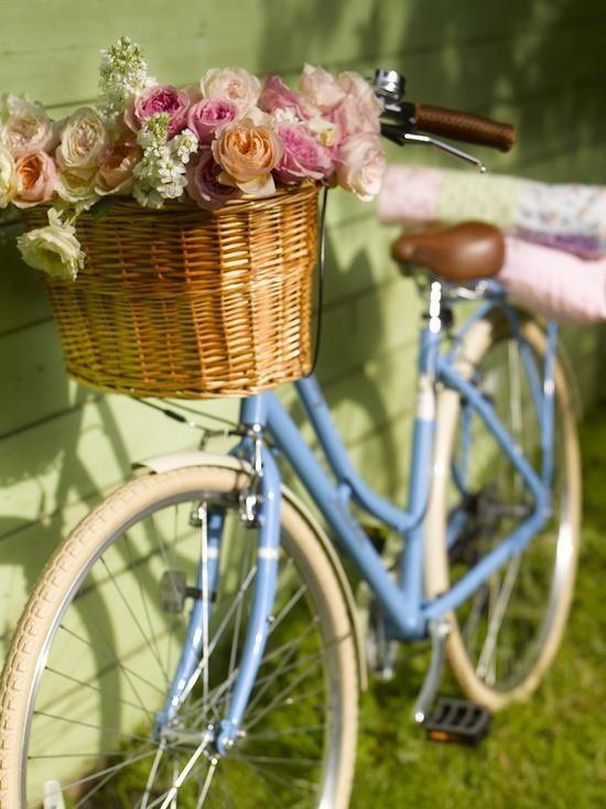 beautiful vintage bike with basket of flowers