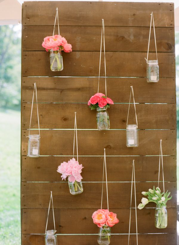 CUTE! Flowers in jars mixed with votive candles, could use the battery powered ones.