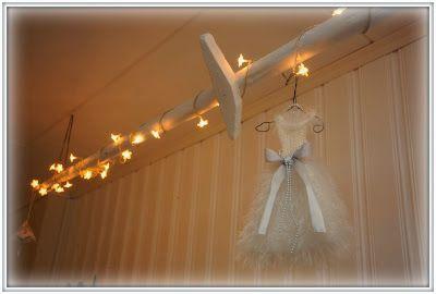 Paint an old hay pole white, add christmas lights and some decor. Hang it all onto the wall.  Valkoisen lumoissa: Näpertelyä