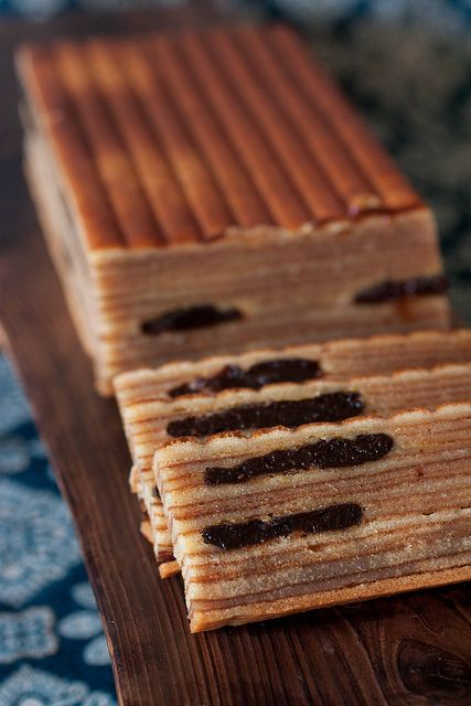 Kueh Lapis or Spekkoek is a Dutch Indonesian butter spice cake made by grilling layer upon impossibly thin layer of batter.
