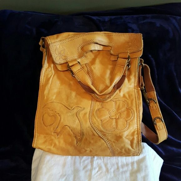 Lucky Brand crossbody leather bag Lucky crossbody bag mustard yellow handles and a strap slight discoloration from dark jeans also small  stain  on top of the bag. Otherwise great bag good quality great shape Lucky Brand Bags Crossbody Bags