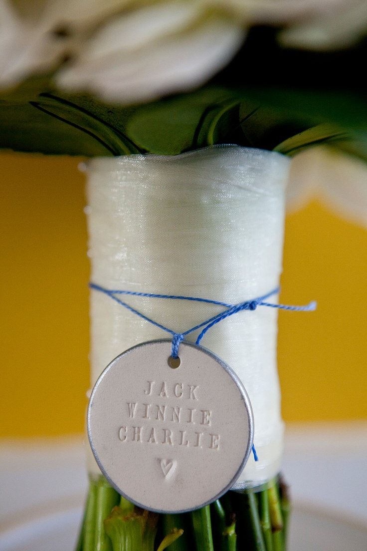 Cute pendant around bridal bouquet (this was the names of the bride and groom's cats)  sydney wedding photographers