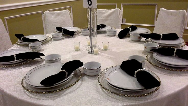 simple table setting with ivory pearl napkin rings and gold beaded charger plates; design by Davis Floral Creations