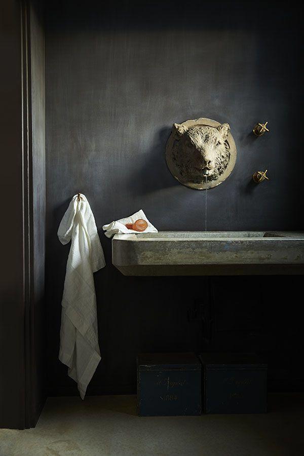 Concrete basin in dark grey bathroom