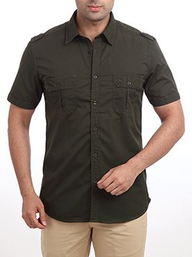Give yourself a different look this season with this casual yet smart chic shirt by Raymond. This shirt is designed to give you a modern look. This designer shirt features pockets on both the sides with button flaps on it. The shoulder flaps look smart and give it a new look when worn. Crafted from superior quality cotton, this slim fit shirt will look great on light colored jeans or trousers and casual sport shoes. The shirt has broad collars and is short sleeved to keep your relaxed all…