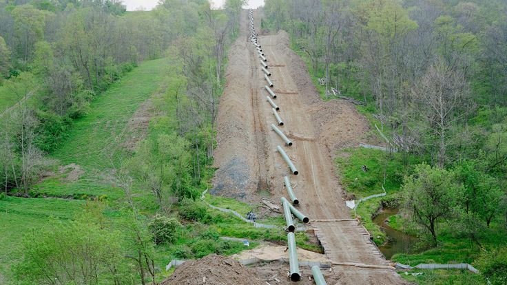 In this picture, the pipeline that is being assembled is taking up much open land. This open land could be used for many other helpful things, such as crops or more homes. Instead, there is a gas pipeline that is being put into place, which is now damaging the environment. The gas is now affecting the environment, by polluting the air, and making it dangerous for others to breath.