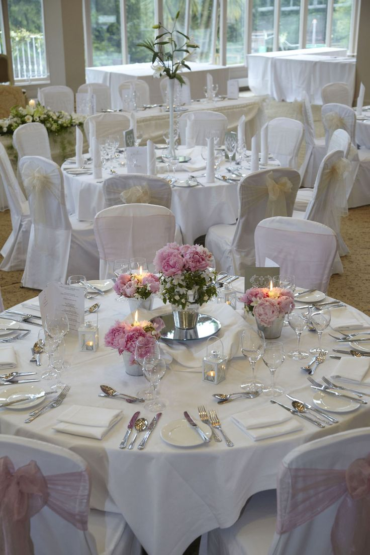 Table set up with pink roses and tea lights
