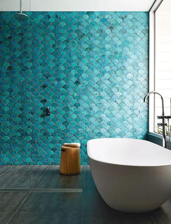 turquoise fishscale tile walls + concrete floor + tall window + ...