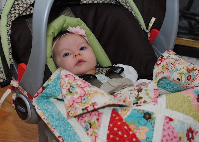 Car Seat Quilt that ties to the handle so baby can't kick it off.