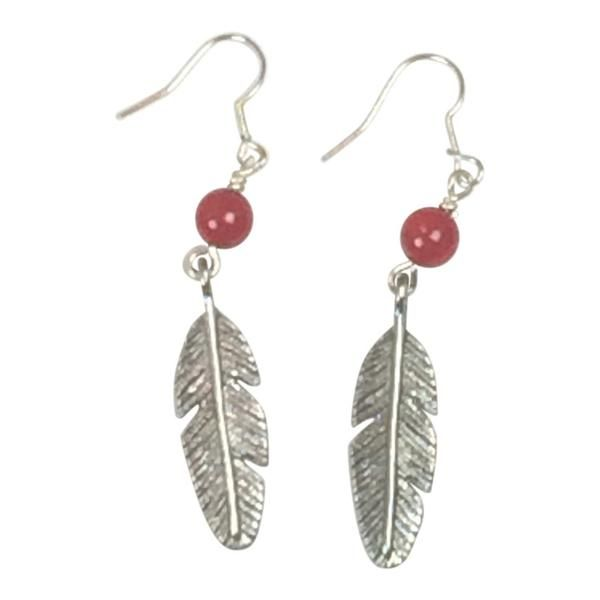 With a splash of color and leaf detailing, these silver earrings kick it up a notch. Artisans in Zambia used semi-precious stones to created these.