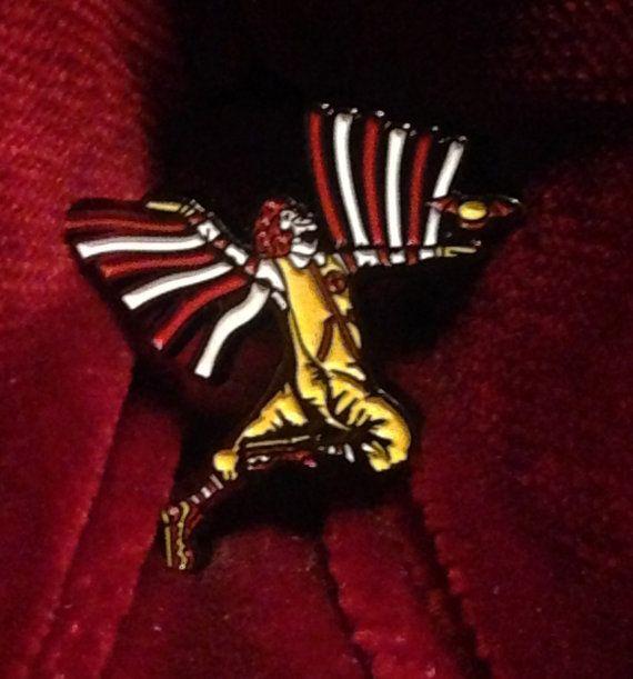 Mac Sabbath logo enamel pin on black metal flying clown