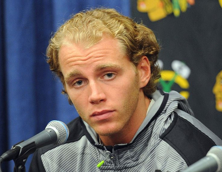 An attorney for the woman who has accused  Blackhawks  star  Patrick Kane  of sexual assault claims the police evidence bag that once contained the accuser's rape kit was left anonymously on her mother's doorstep, an explosive allegation that prompted dueling news conferences Wednesday and could taint the ongoing investigation.