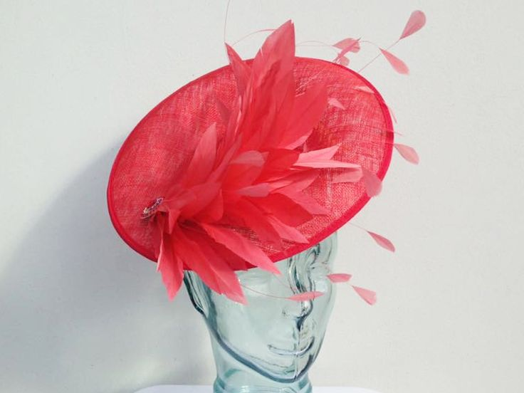 'Wheels On Fire' Saucer Hatinator available to buy online or in store at Hadleigh Hats in Essex.    This item can be bespoke made in other colours.     coral, red, saucer, hatinator, feather, brooch, wedding, ascot, occasion, races, ladies day, mother of the bride, mother of the groom, bespoke, personalised
