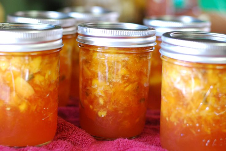 Peach Jalepeno Jam. My jars have a few more green spots..... I used all five peppers  :)
