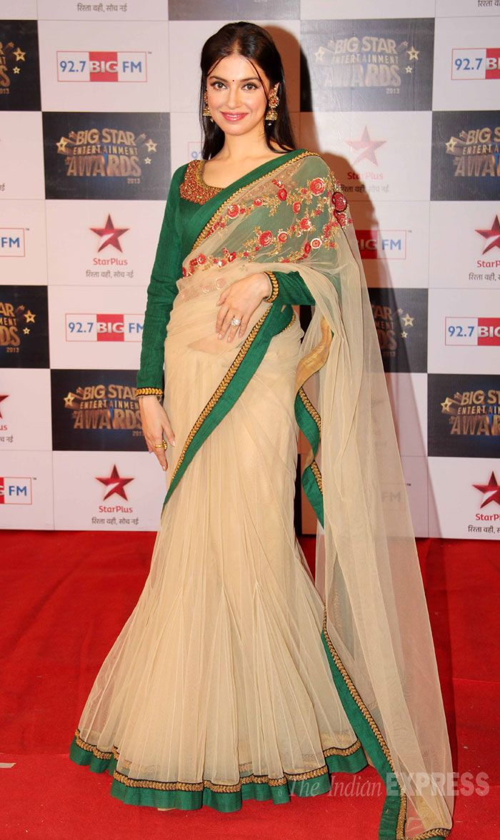 Divya Khosla Kumar looked pretty in a beige sari lehenga by Sabyasachi on the red carpet at the Big Star Entertainment Awards.