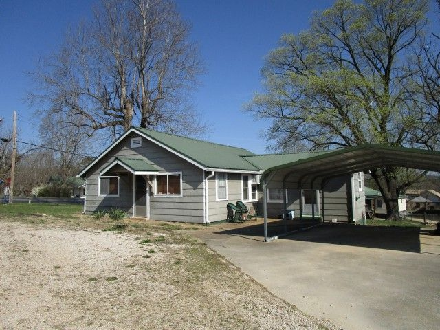 House in town for sale in the Ozarks! 2 bedroom, 1 bath cottage on 0.48 acre m/l. Includes living room, dining and eat-in kitchen, 1 room walkout basement, 2 car carport, nice yard. This property joins commercial property. ***Can be purchased in addition to the commercial property #40140 - commercial property must sell with or before this home can be purchased. This property is located in Shannon County, at 17924 Main Street, in Eminence, MO 65466. It is just minutes from Jacks Fork river