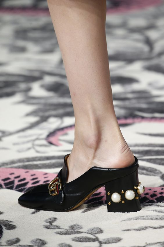 Mules and slip-on shoes are huge this season. I'm drooling over this pair by Gucci