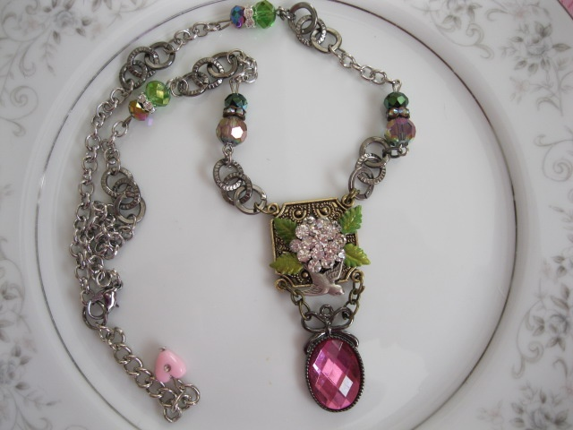 Handpainted roses, vintage style jewelry and broken china mosaics at Once in a Pink Moon..... what's not to LOVE!!