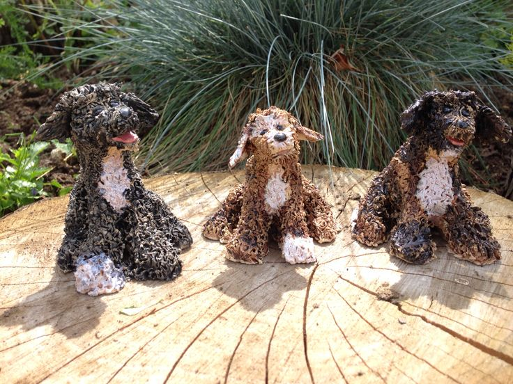 Small scruffy mutts, labradoodle, ceramic dog